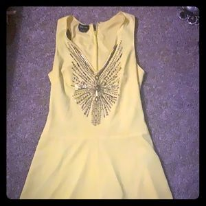 Bebe yellow romper with gold embellishment